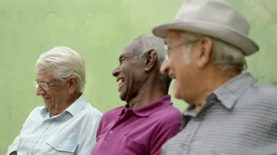 stock-footage-active-retirement-and-senior-people-group-of-three-old-male-friends-talking-and-laughing-on-bench
